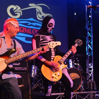 Pete playing bass dressed as a zombie, with Alan, playing guitar, dressed as a skeleton.