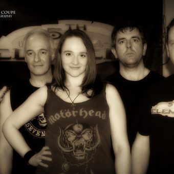 Richard, Neil, Ann, Alan and Phil posing for a group photo. Sepia.