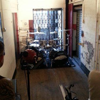 Sam Fenton filming Phil's drum kit.