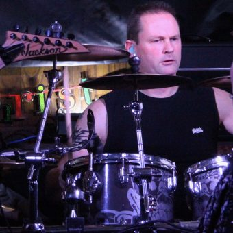 Phil playing drums.