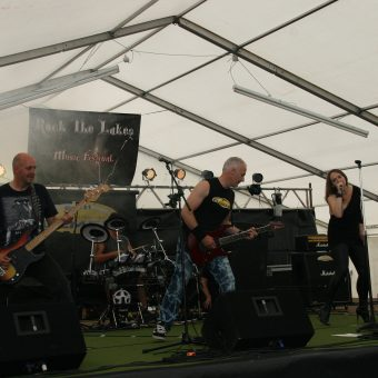 The band playing on stage.