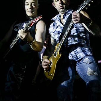 Neil and Alan playing guitar.