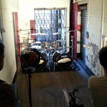 Sam Fenton filming Phil's drum kit.