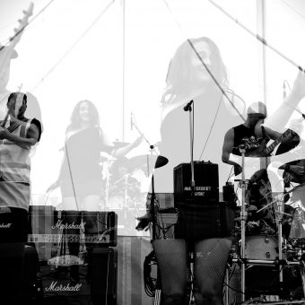 The band performing, multi-layered effect, black and white.