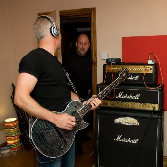 Richard interrupting Neil recording at the studio to tell him to turn it down.
