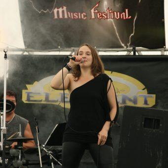 Ann singing on stage.