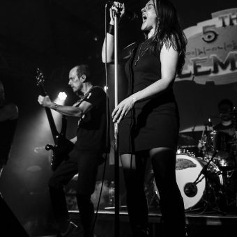 Dave playing bass, while Ann belts on her mic. Black and white.