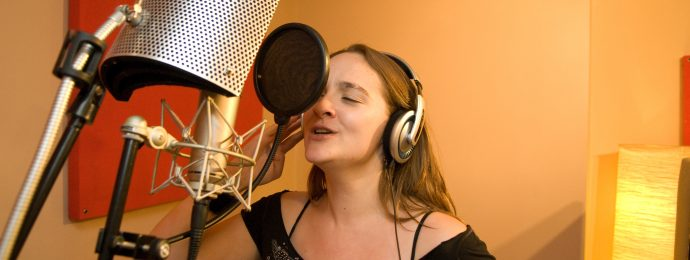 Ann recording vocals in the studio.