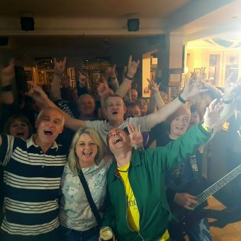 The crowd at Saith Seren, Wrexham, cheering and waving their arms.