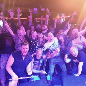 The crowd at Bootleggers, Kendal, cheering and waving their arms.