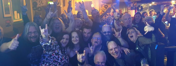 The crowd at the Bath, Morecambe, smiling, cheering and waving their arms