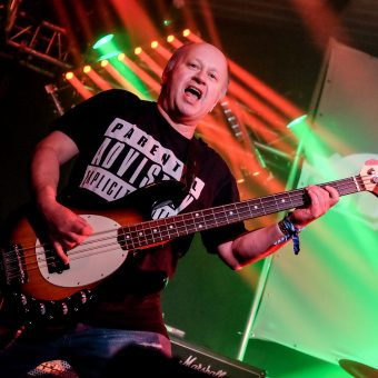 Pete singing and playing bass.