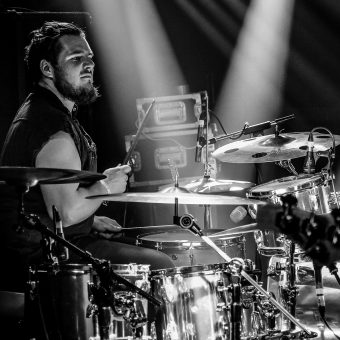 Aaron playing drums. Black and white.