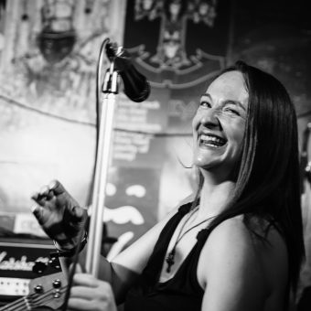 Ann laughing off the mic, black and white.