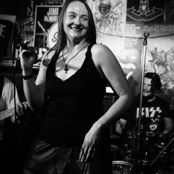 Ann on stage, smiling, black and white.