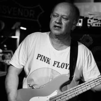Pete playing bass, black and white.
